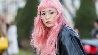 PARIS, FRANCE - MARCH 03: A model with glasses and pink hair outside Dior on March 3, 2017 in Paris, France. (Photo by Christian Vierig/Getty Images)