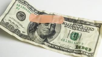 Bandaid over 100 dollar bill...