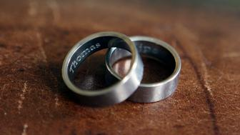 In this photo taken March 22, 2015, the rings of Thomas Kostura and Ijpe DeKoe sit on a table in their Memphis, Tenn. apartment. According to an Associated Press-GfK poll in April, nearly half of Americans favor laws allowing gay and lesbian couples to wed in their own states, while just over a third are opposed. The poll was conducted just before the Supreme Court heard oral arguments in a case that will probably decide whether states can continue to bar same-sex couples from marrying. Kostura and deKoe were married in New York in 2011.  (AP Photo/Karen Pulfer Focht)