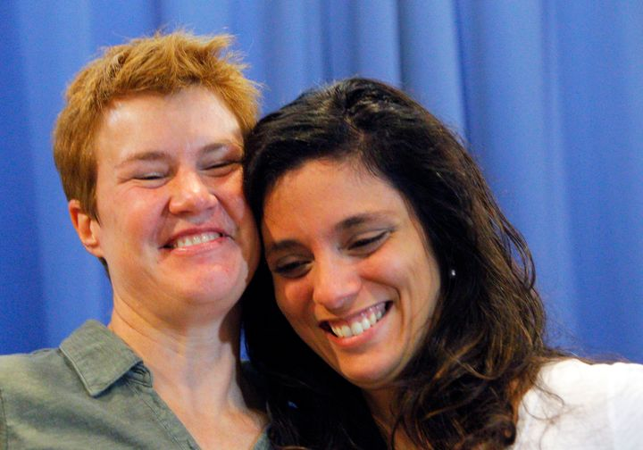 Val Tanco (right) and Sophie Jesty smile during a news conference in Knoxville, Tennessee, on June 26, 2015. They were a