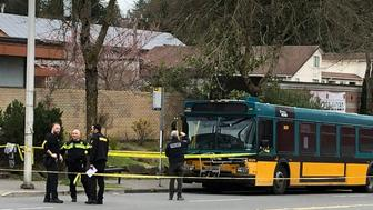 REMOVES SPECIFIC NUMBER OF PEOPLE WHO WERE SHOT, AS STORY DETAILS CONTINUE TO DEVELOP Investigators work on the scene of a shooting in Seattle on Wednesday, March 27, 2019. (AP Photo/Gene Johnson)