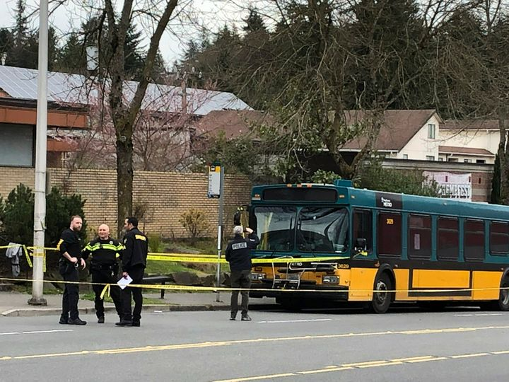 Investigators work on the scene of a shooting in Seattle on Wednesday, March 27, 2019. (AP Photo/Gene Johnson)