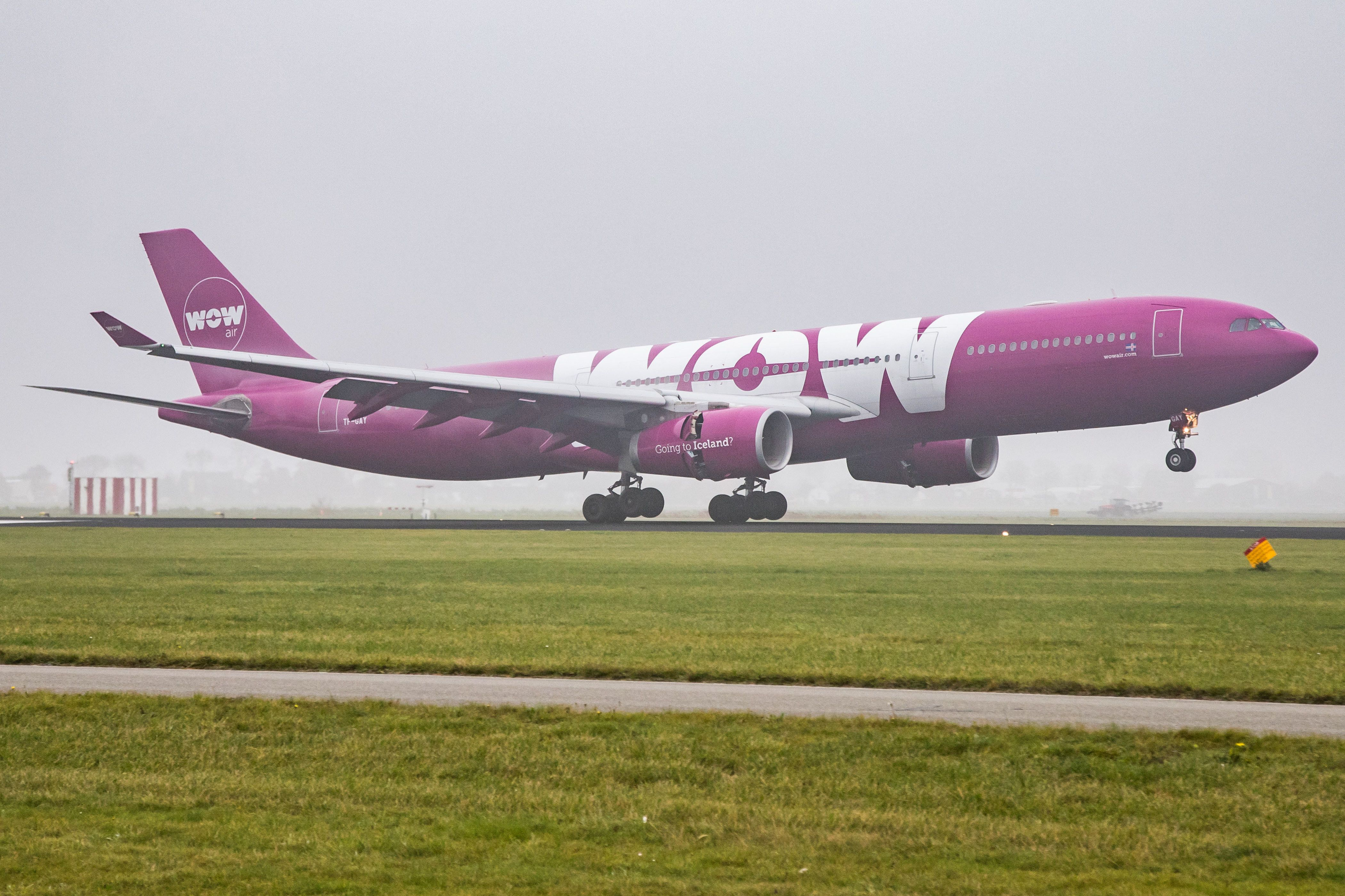 WOW air Airbus A330-343 with registration TF-GAY landing at Amsterdam Schiphol AMS / EHAM International Airport in the Netherlands. The airline connects Amsterdam to Reykjavík Keflavík Airport. The airline performs low cost transatlantic flights through Iceland. (Photo by Nicolas Economou/NurPhoto via Getty Images)