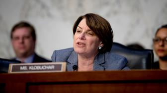 Sen. Amy Klobuchar, D-Minn., speaks as Federal Aviation Administration Acting Administrator Daniel Elwell, National Transportation Safety Board Chairman Robert Sumwalt, and Department of Transportation Inspector General Calvin Scovel appear before a Senate Transportation subcommittee hearing on commercial airline safety, on Capitol Hill, Wednesday, March 27, 2019, in Washington. Two recent Boeing 737 MAX crashes, in Ethiopia and Indonesia, which killed nearly 350 people, have lead to the temporary grounding of models of the aircraft and to increased scrutiny of the FAA's delegation of a number of aspects of the certification process to the aircraft manufacturers themselves. (AP Photo/Andrew Harnik)