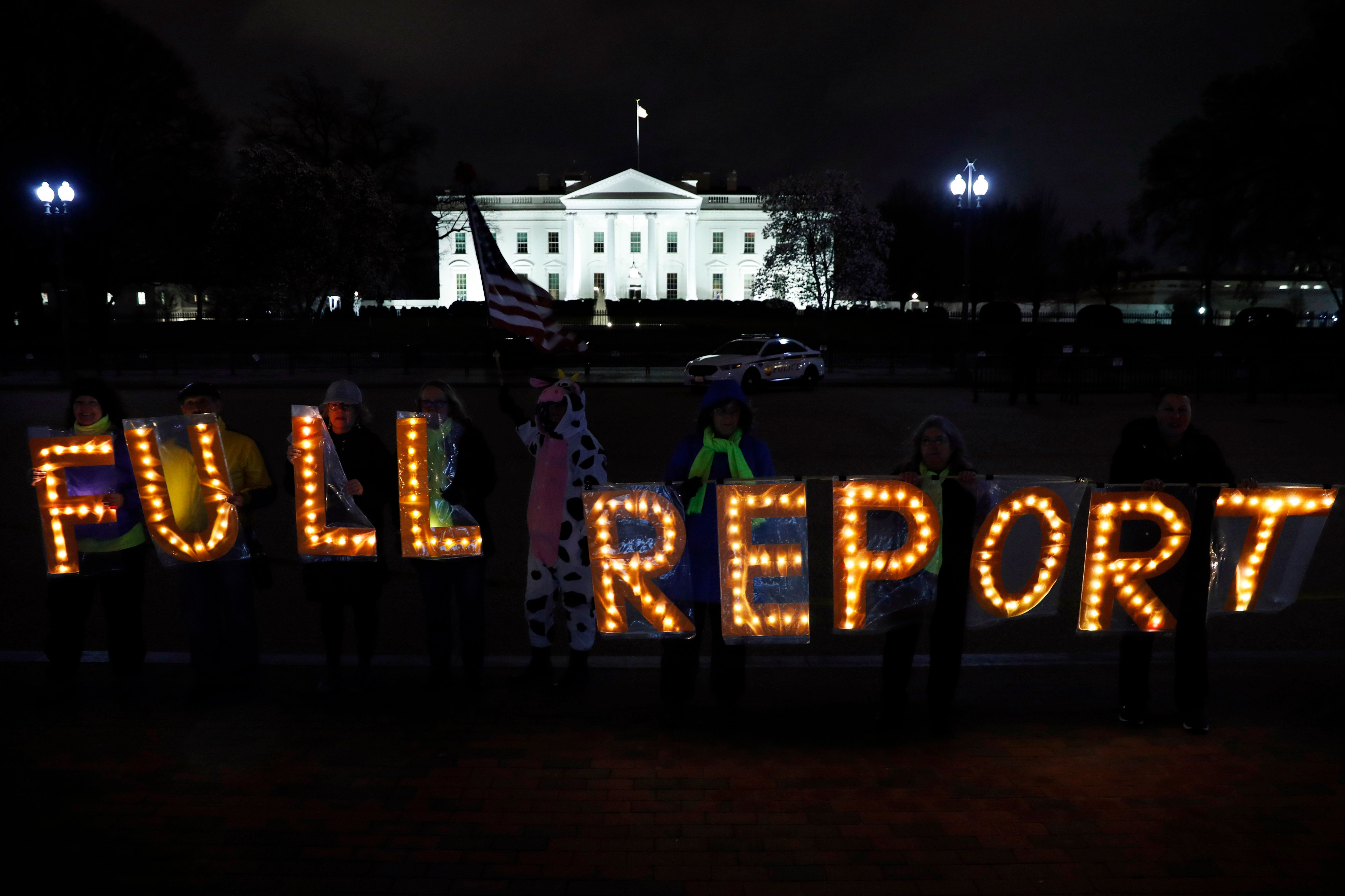 "Members of the protest group Herndon Reston Indivisible and Kremlin Annex hold signs saying ""Full Report,"" outside the White House in Washington, Monday, March 25, 2019, as they protested for the complete results to be released of special counsel Robert Mueller's investigation into Russian election interference and possible coordination with associates of President Donald Trump. (AP Photo/Jacquelyn Martin)"