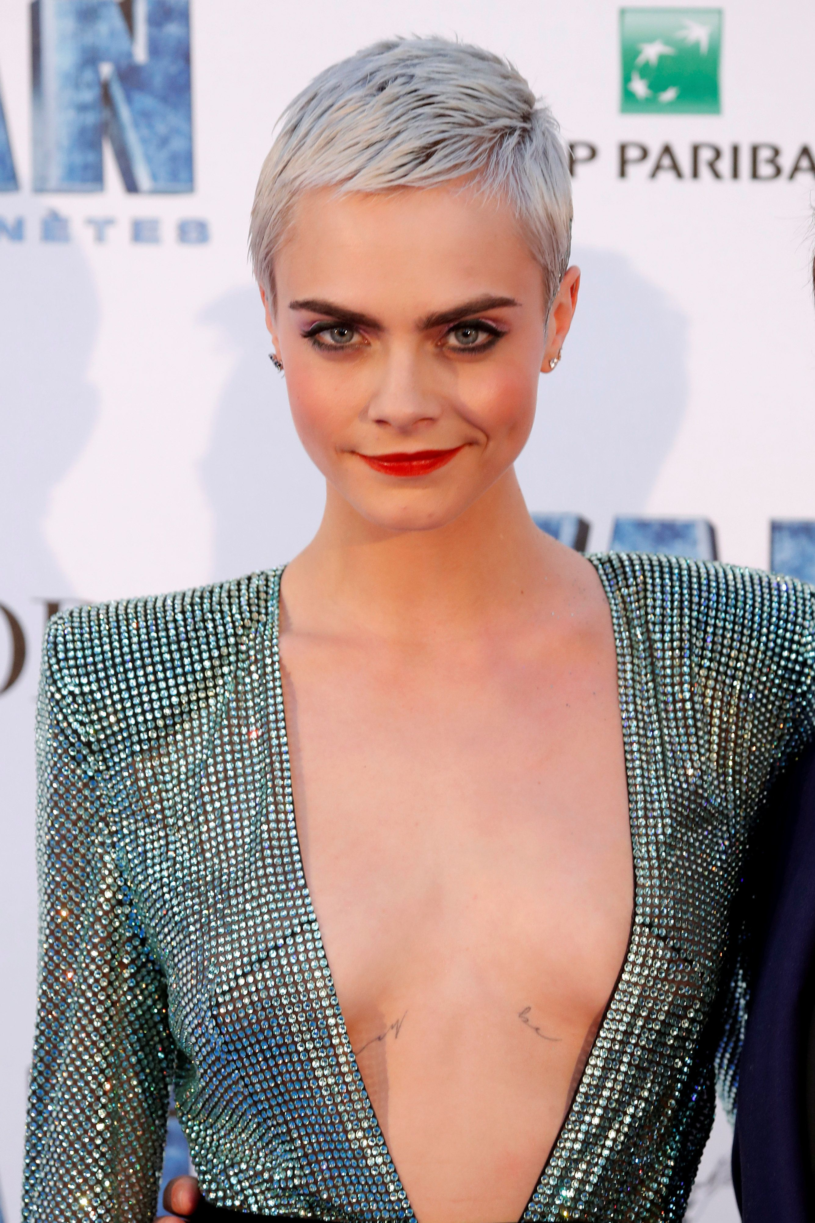 "Cast member Cara Delevingne poses as she arrives for the premiere of the film ""Valerian and the City of a Thousand Planets"" in Saint-Denis near Paris, France, July 25, 2017.   REUTERS/Charles Platiau"