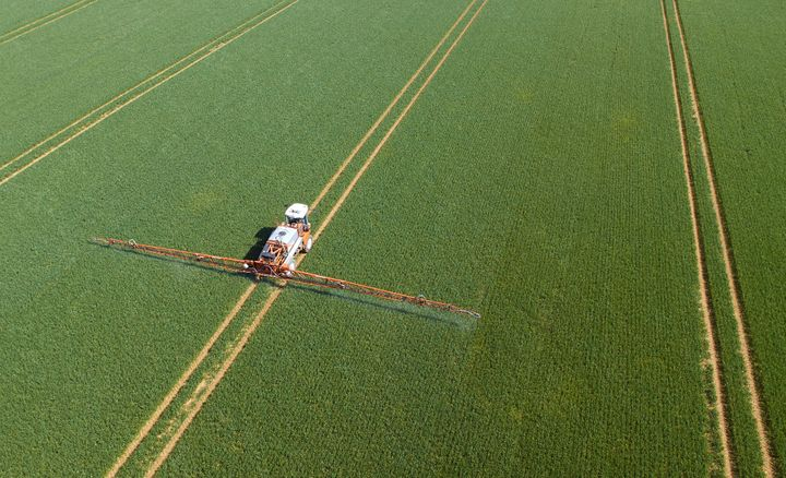 Pesticides being sprayed on crops.