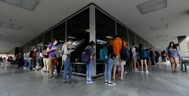 Voters, mostly students, wait to vote at a primary election polling site on the University of Texas campus in Austin, Texas,