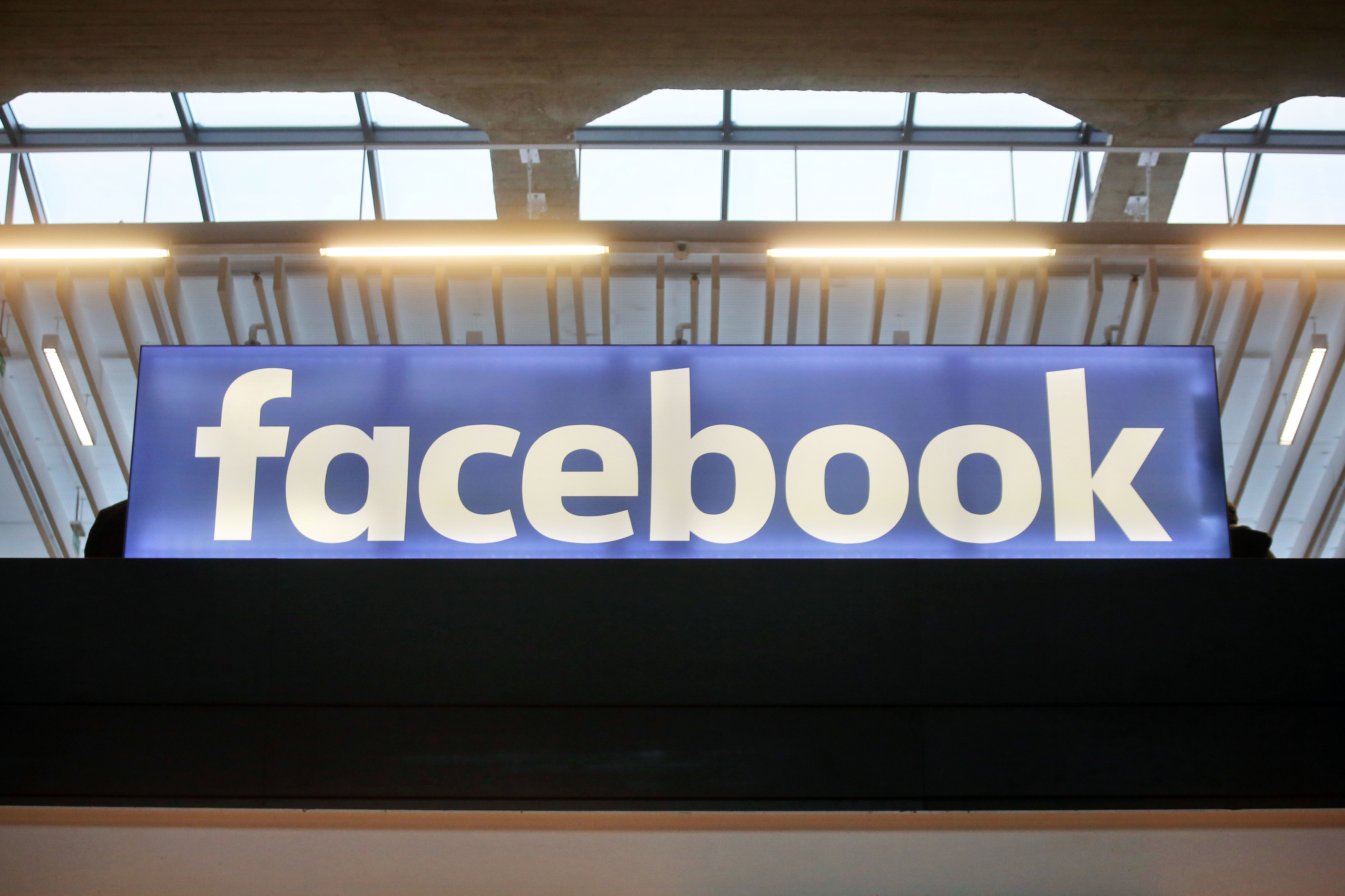Facebook logo is displayed in a start-up companies gathering at Paris' Station F, in Paris, Tuesday, Jan. 17, 2017. (AP Photo/Thibault Camus)