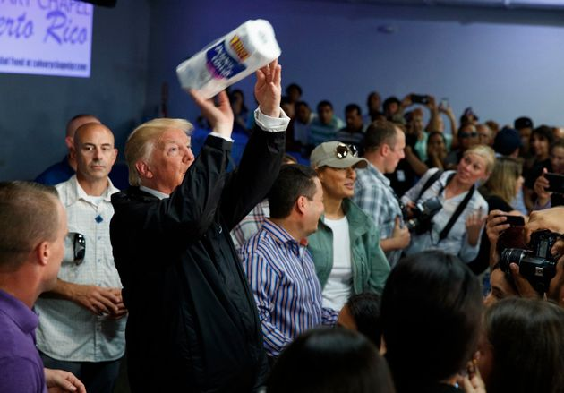 In his first visit to the island after Hurricane Maria, Trump tossed paper towels at survivors, who were...