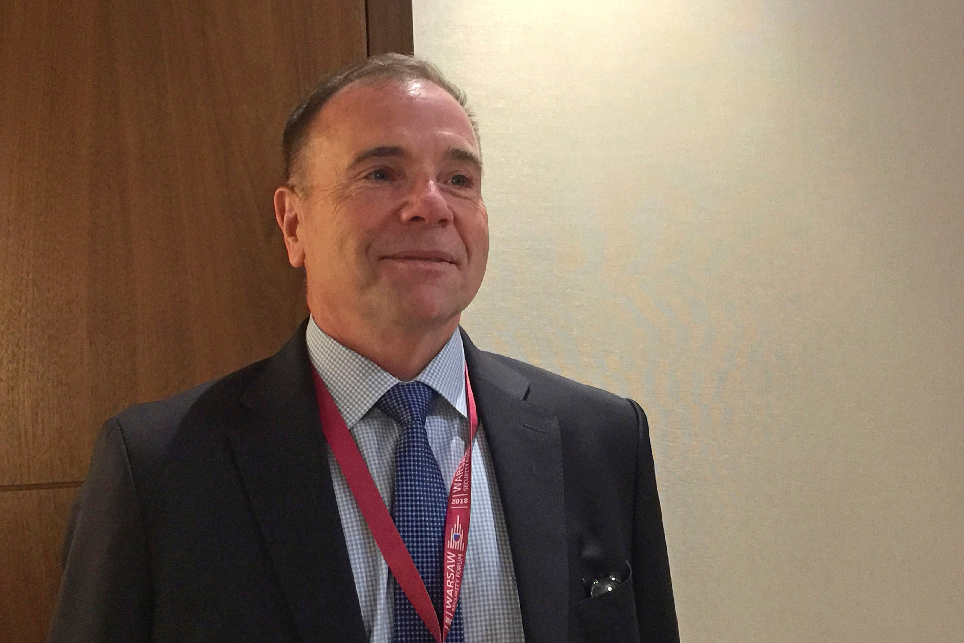 Retired Lt. Gen. Ben Hodges speaks to reporters on the sideline of the Warsaw Security Forum in Warsaw, Poland, Wednesday Oct. 24, 2018.  Hodges, who was U.S. Army commander in Europe from 2014-17, told the forum that it's likely but not inevitable that the United States will be at war with China in 15-years. (AP Photo/Vanessa Gera)