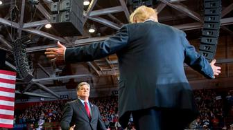 TOPSHOT - US President Donald Trump greets talk show host Sean Hannity at a Make America Great Again rally in Cape Girardeau, Missouri on November 5, 2018. (Photo by Jim WATSON / AFP)        (Photo credit should read JIM WATSON/AFP/Getty Images)