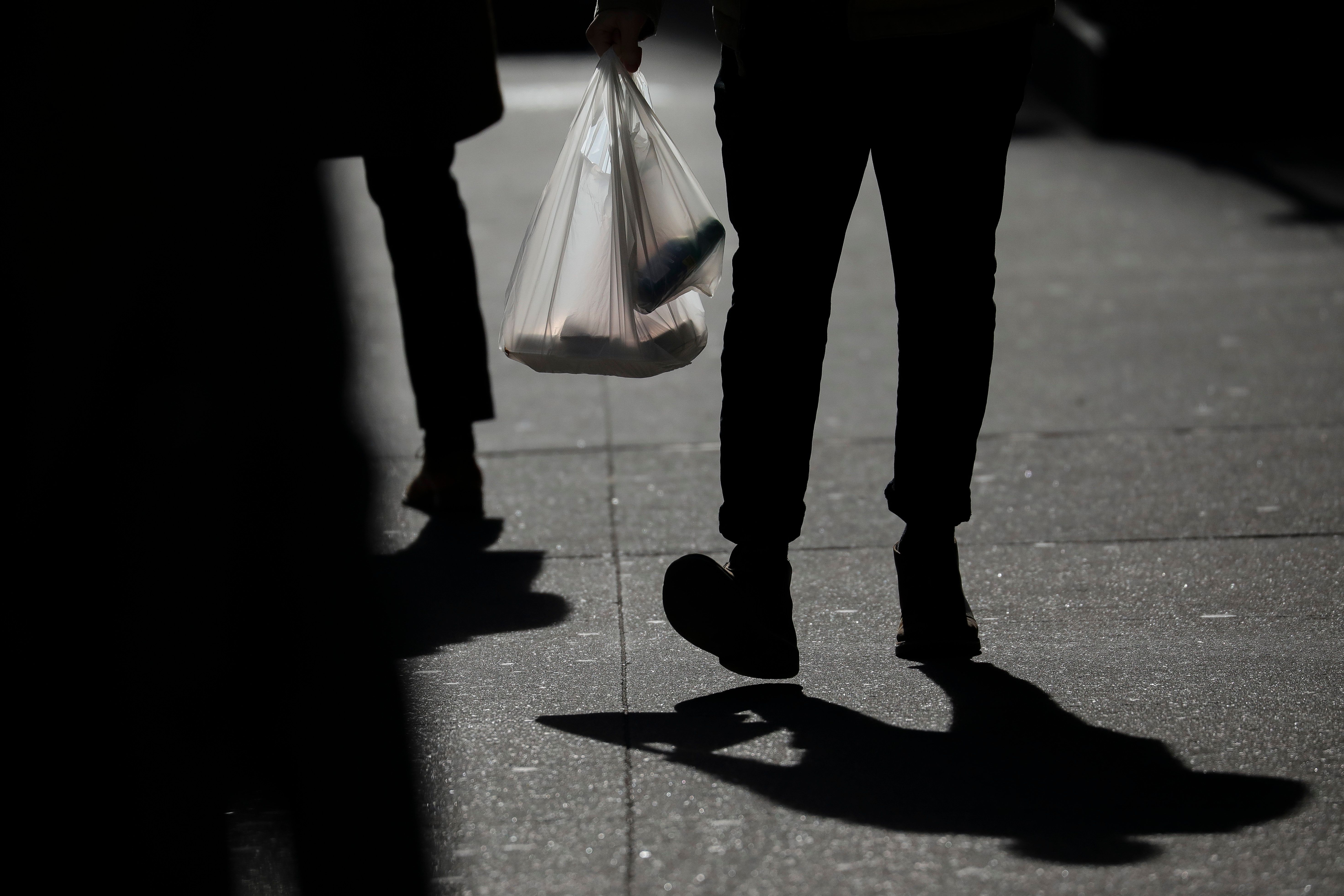 NEW YORK, NY - JANUARY 15: A person carries a plastic bag during the lunch hour in Lower Manhattan, January 15, 2019 in New York City. New York Governor Andrew Cuomo is planning to push for a statewide ban on single-use plastic shopping bags as part of his 2019 budget, which he is scheduled to introduce in Albany on Tuesday. (Photo by Drew Angerer/Getty Images)