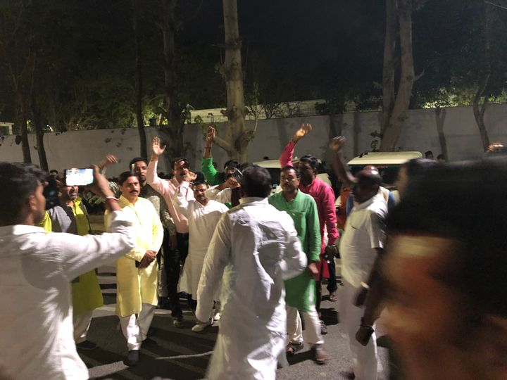 RJD workers protesting in front of Lalu Prasad Yadav's home in Patna over ticket distribution.