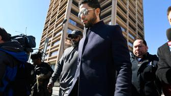 "Actor Jussie Smollett leaves Cook County Court after his charges were dropped Tuesday, March 26, 2019, in Chicago. Prosecutors on Tuesday abruptly dropped all charges against Smollett, defense attorneys said, apparently abandoning the case barely five weeks after the ""Empire"" actor was accused of lying to police about being the target of a racist, anti-gay attack in downtown Chicago. (AP Photo/Paul Beaty)"