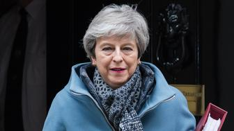 British Prime Minister Theresa May leaves 10 Downing Street in central London for the weekly PMQ session in the House of Commons on 27 March, 2019. Today, MPs will hold a series of indicative votes on alternative Brexit plans following a government defeat in the Commons as parliamentarians took control of the order paper. (Photo by WIktor Szymanowicz/NurPhoto via Getty Images)