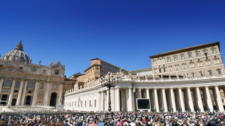 Pope Francis (second window from top right) addresses worshippers at St.Peter's square during the weekly Angelus prayer on Ma