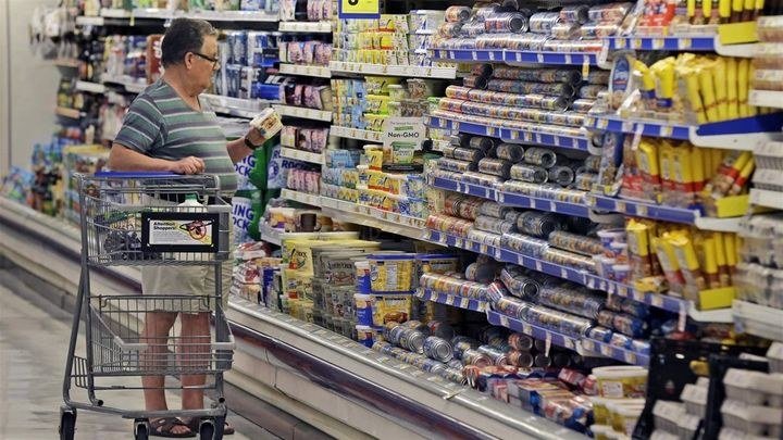 A shopper looks at food labels in Texas. Standards for food date labels vary by state and are confusing to many consumers.