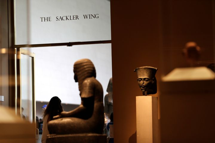 A sign with the Sackler name is displayed at the Metropolitan Museum of Art in New York. The Sackler name adorns walls at som