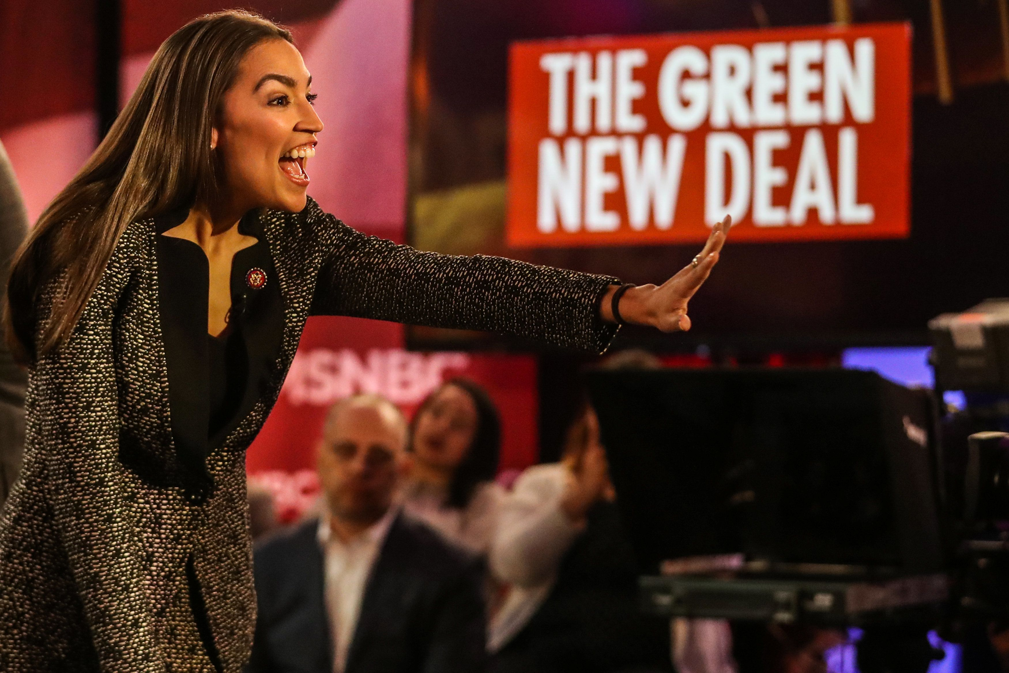"""U.S. Representative Alexandria Ocasio-Cortez (D-NY) greets audiences following a televised town hall event on the """"Green New Deal"""" in the Bronx borough of New York City, New York, U.S., March 29, 2019. REUTERS/Jeenah Moon"""
