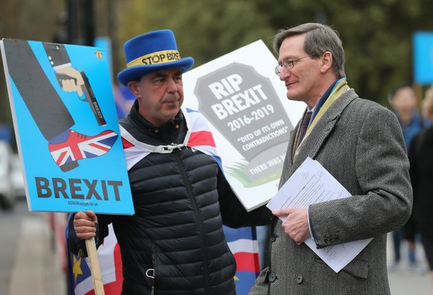Dominic Grieve MP is confronted by anti-Brexit campaigner Steve Bray on his way to the Houses of Parliament...