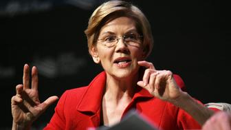 Elizabeth Warren said she believes a woman who accused former Vice President of inappropriately touching her.