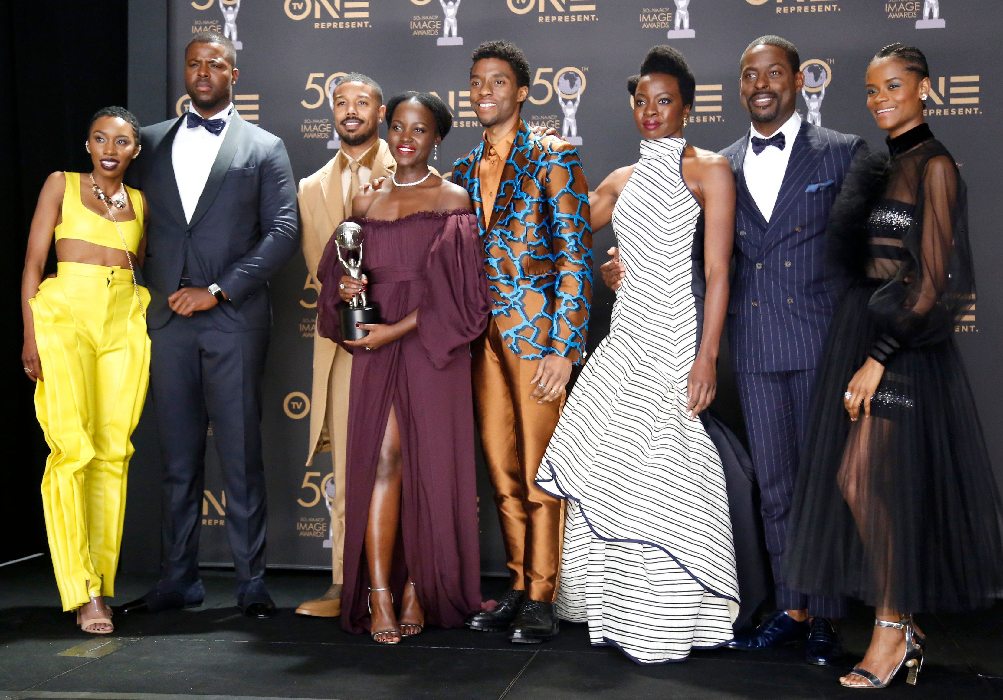 HOLLYWOOD, CALIFORNIA - MARCH 30: (L-R) Carrie Bernans, Winston Duke, Michael B. Jordan, Lupita Nyong'o, Chadwick Boseman, Danai Gurira, Sterling K. Brown, and Letitia Wright, winners of Outstanding Motion Picture and Outstanding Ensemble Cast in a Motion Picture for 'Black Panther', attend the 50th NAACP Image Awards at Dolby Theatre on March 30, 2019 in Hollywood, California. (Photo by Liliane Lathan/Getty Images for NAACP)
