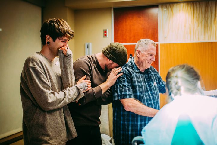 Elliot Dougherty, Matthew Eledge and Kirk Eledge share an emotional moment during Uma's delivery.