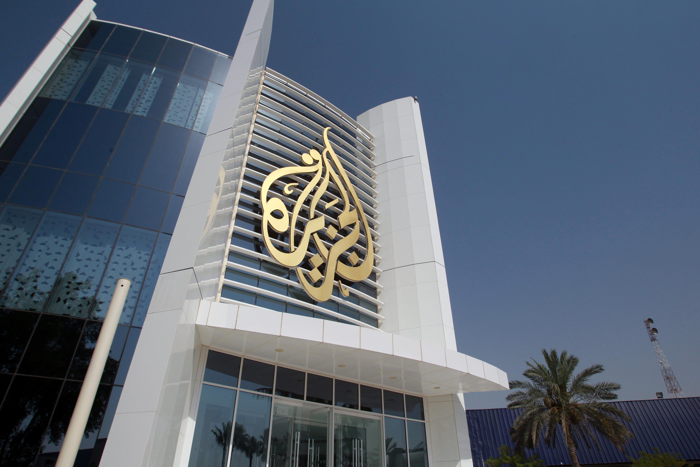 The Al Jazeera Media Network logo is seen on its headquarters building in Doha, Qatar, June 8, 2017. (REUTERS/Naseem Zeitoon)