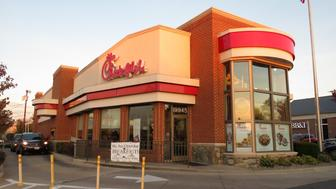 Germantown, USA-October 29, 2016:  This Chick-fil-A fast food restaurant was spotted at sunset in Germantown Maryland.  A car is at the drive through window ordering food.  Chick-fil-A is chain of 2000 restaurants in the USA and Canada specializing in chicken fast food.