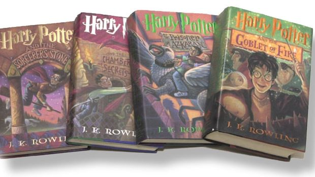 "Harry Potter books I - IV:  ""Sorcerer's Stone"", ""Chamber Of Secrets"", ""Prisoner Of Azkaban"" and ""Goblet Of Fire"" (l-r), graphic element on white"