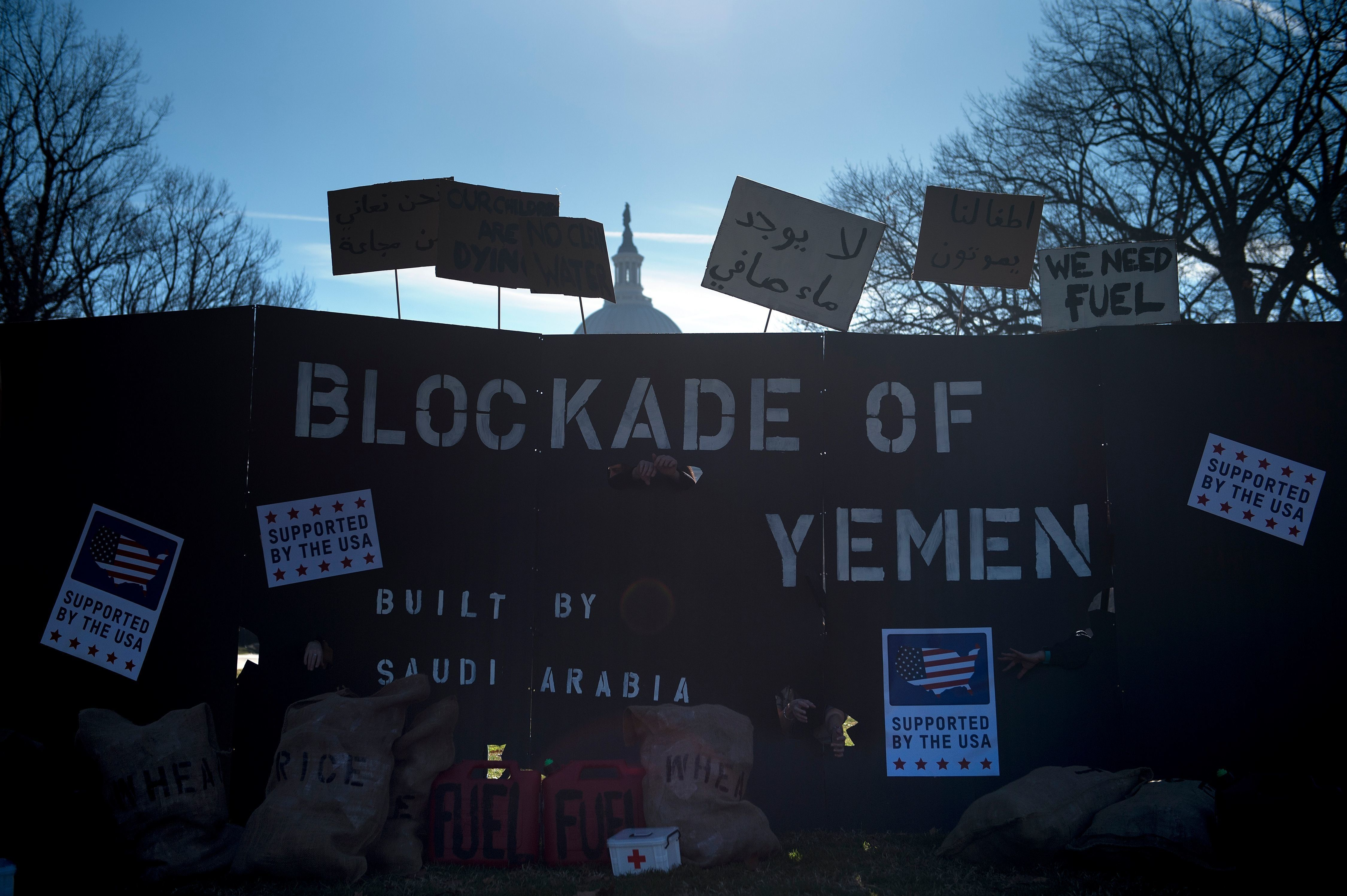 Activists rally against Saudi Arabia's blockade of Yemen on Capitol Hill December 18, 2017 in Washington, DC. / AFP PHOTO / Brendan Smialowski        (Photo credit should read BRENDAN SMIALOWSKI/AFP/Getty Images)