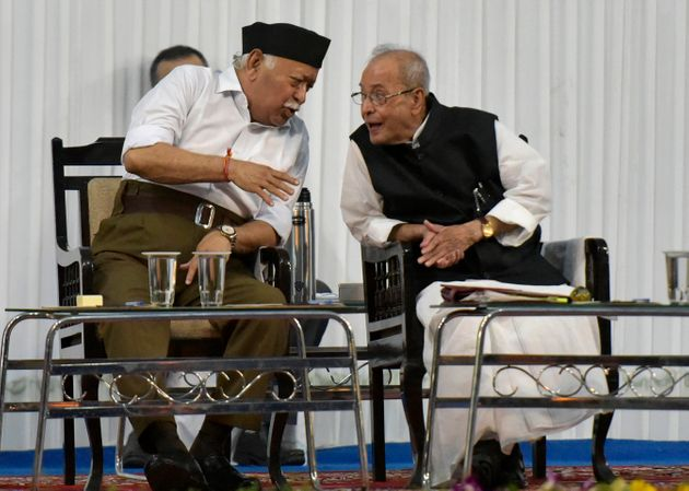 Former President Pranab Mukherjee, right, speaks with Mohan Bhagwat, RSS Chief, in July 2018. In recent...