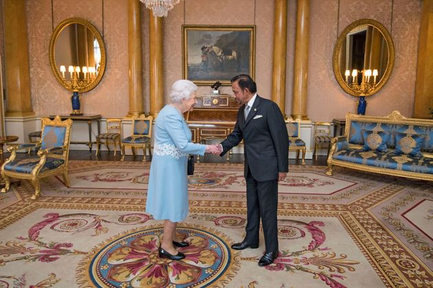 The Sultan of Brunei meeting Queen Elizabeth at Buckingham Palace last year. He was awarded an honorary...