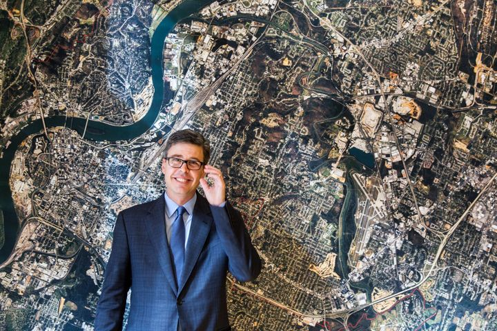 Chattanooga, Tennessee, Mayor Andy Berke stands in front of an aerial image of the city in November 2014. Berke has been a ma