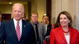 Vice President Joe Biden and House Minority Leader Nancy Pelosi of Calif., leave a meeting with the House Democratic Caucus to discuss the Iran nuclear deal, Wednesday, July 15, 2015, on Capitol Hill in Washington.   (AP Photo/Manuel Balce Ceneta)