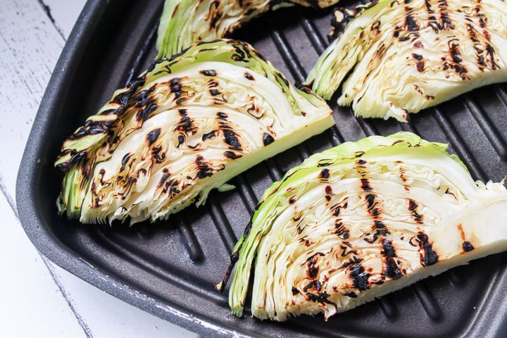 Green cabbage is perfect for slicing into wedges and charring on the grill.
