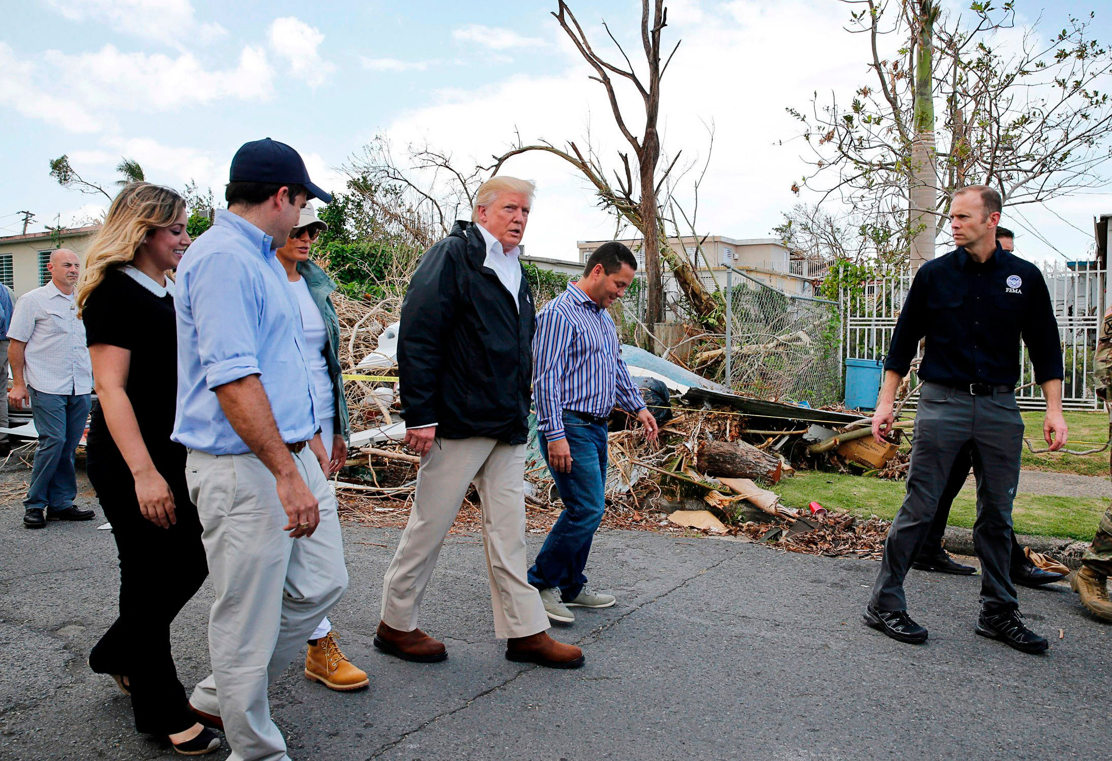 President Trump participates in a walking tour of areas damaged by Hurricane Maria in Guaynabo, Puerto Rico, Oct. 3, 2017. (Jonathan Ernst/Reuters)