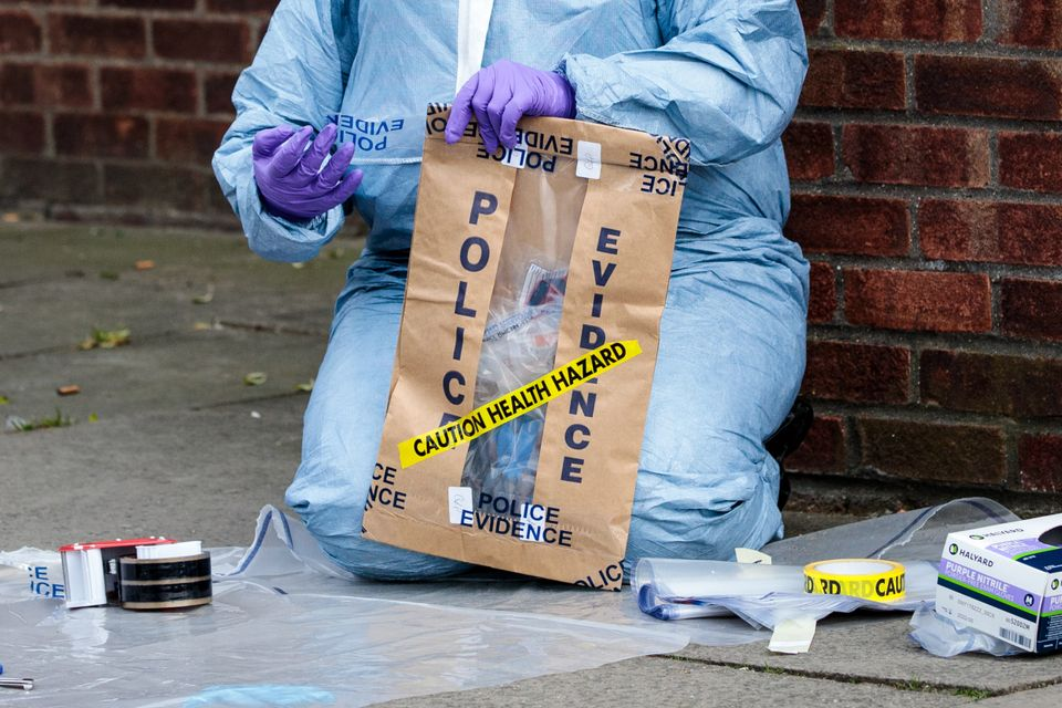 Forensics teams work at the scene of a non-fatal stabbing in Edmonton on March 31,