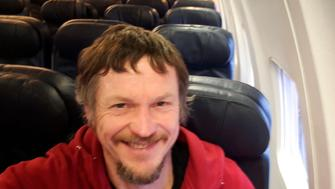 Skirmantas Strimaitis takes a selfie onboard a Boeing 737-800 airplane, taking off from Vilnius, Lithuania, March 16, 2019, as the only passenger aboard. The aircraft with two pilots and five crew members and which usually can sit up to 188 people, flew to Bergamo, Italy. (Skirmantas Strimaitis via AP)