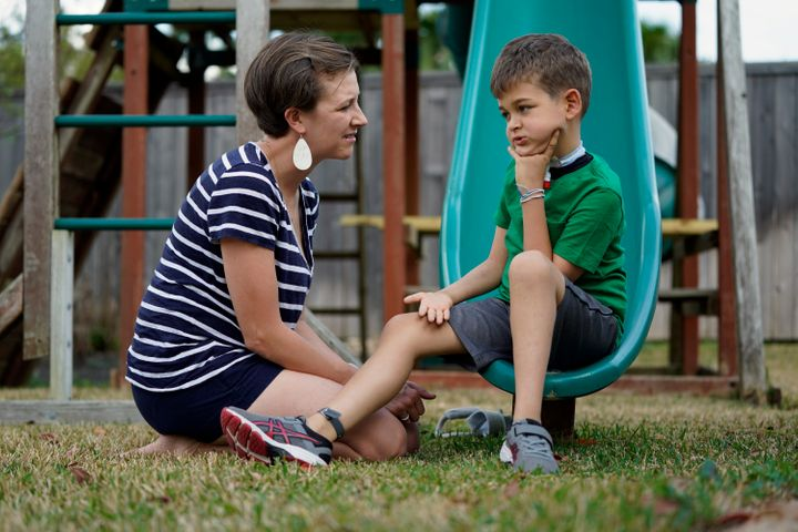 Rachel Scott, left, talks with her son, Braden, in Tomball, Texas on Friday, March 29. Braden has recovered somewhat after in