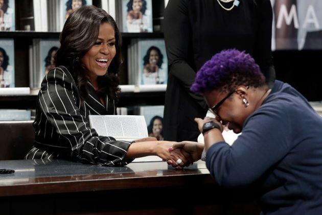Michelle Obama autografa Minha