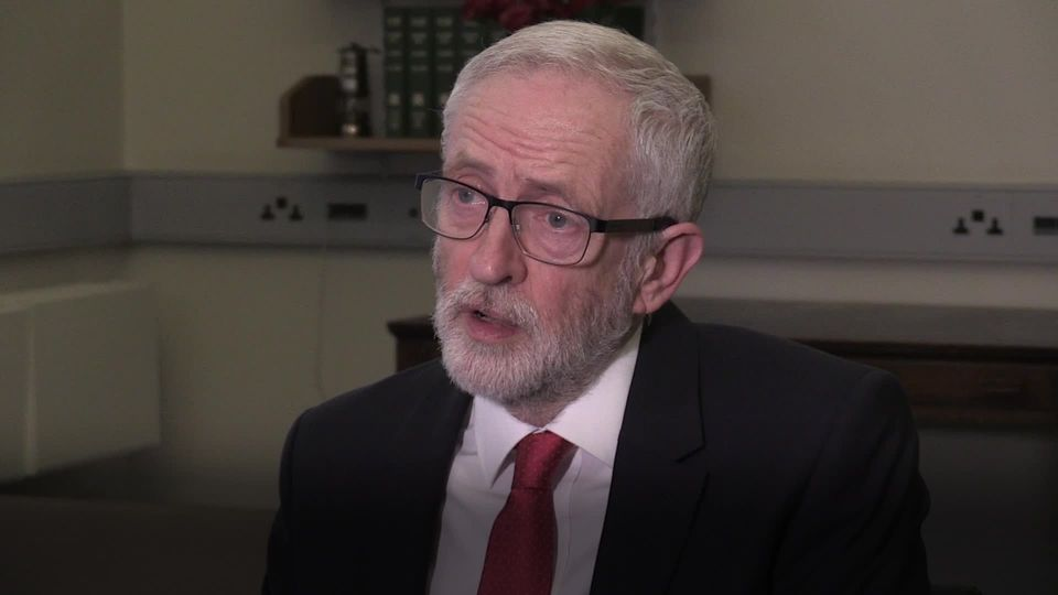 Jeremy Corbyn reacts to the
