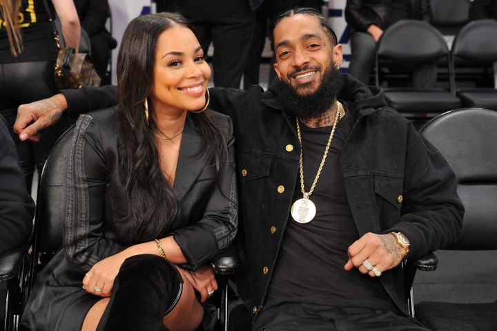 Lauren London and Nipsey Hussle at a Los Angeles Lakers game in November.