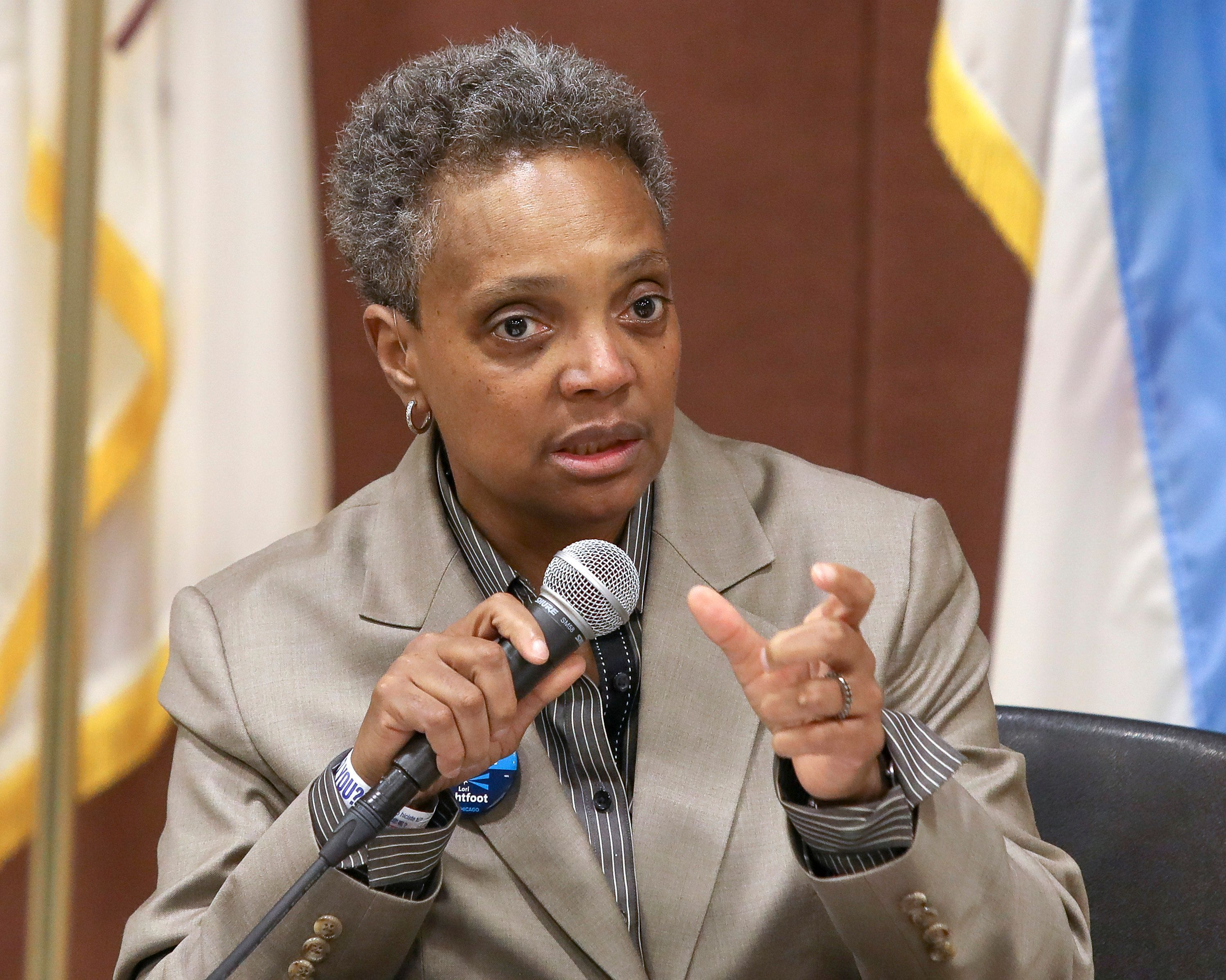 In this March 24, 2019 photo, Chicago mayoral candidate Lori Lightfoot participates in a candidate forum sponsored by One Chicago For All Alliance at Daley College in Chicago. Lightfoot and Toni Preckwinkle, left, are competing to make history by becoming the city's first black, female mayor. On issues their positions are similar. But their resumes are not, and that may make all the difference when voters pick a new mayor on Tuesday. (AP Photo/Teresa Crawford)