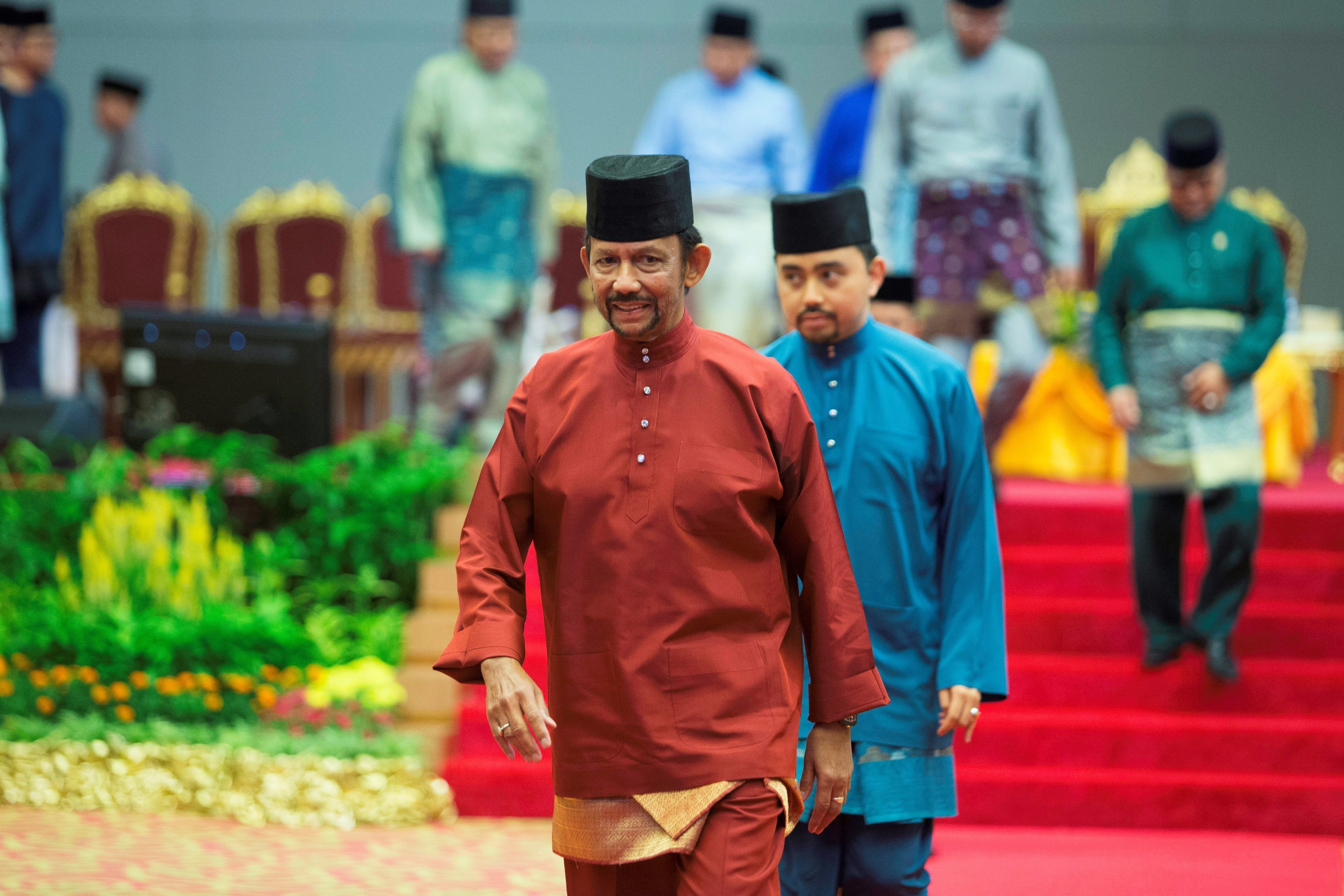 Brunei's Sultan Hassanal Bolkiah leaves after speaking at an event in Bandar Seri Begawan on 3