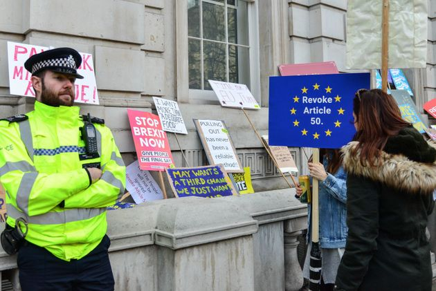 A police officer stands guard during the 'Put it to the people' anti-Brexit march on April
