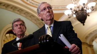 Senate Majority Leader Mitch McConnell of Ky., speaks to members of the media alongside Sen. Roy Blunt, R-Mo., following a Senate policy luncheon, Tuesday, April 2, 2019, on Capitol Hill in Washington. (AP Photo/Patrick Semansky)