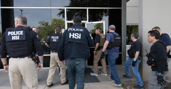 ICE Homeland Security Investigations agents conduct a workplace raid Wednesday in North Texas, the largest such raid in