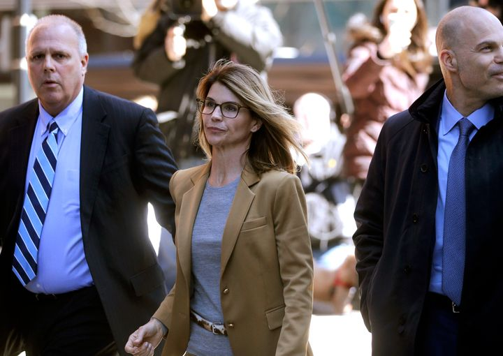 Actress Lori Loughlin, center, appeared in court on Wednesday along with some of the other parents charged in